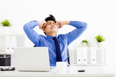 Stressed businessman working in the office Stock Photography