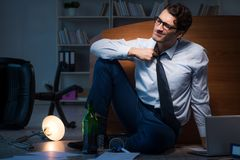 The stressed businessman working overtime in depression. Stressed businessman working overtime in depression Royalty Free Stock Photography