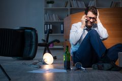 The stressed businessman working overtime in depression. Stressed businessman working overtime in depression Royalty Free Stock Photo