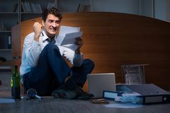 The stressed businessman working overtime in depression. Stressed businessman working overtime in depression Royalty Free Stock Image