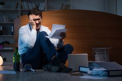 The stressed businessman working overtime in depression. Stressed businessman working overtime in depression Royalty Free Stock Images