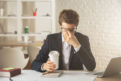 Stressed businessman at workplace Royalty Free Stock Photos