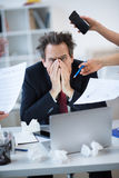Stressed businessman at workplace Royalty Free Stock Images
