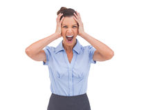 Stressed businessswoman with hand on her head Royalty Free Stock Images