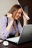 Stressed businesswoman Stock Image