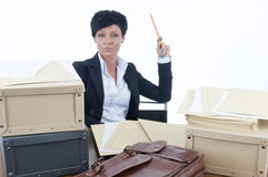 Stressed businesswoman. Sitting at her desk Stock Photography