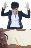 Stressed businesswoman. Sitting at her desk Royalty Free Stock Image