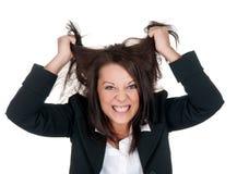 Stressed businesswoman. Ruffles her hair Stock Photos