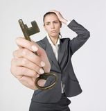 Stressed businesswoman. A studio portrait of a very anxious businesswoman holding the key of success Stock Photography