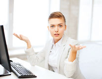Stressed businesswoman with computer Royalty Free Stock Images