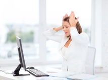 Stressed businesswoman with computer at work Royalty Free Stock Photos