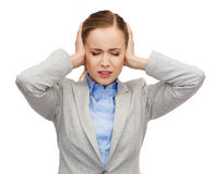 Stressed businesswoman with covered ears Royalty Free Stock Photo