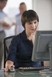 Stressed Businesswoman at Desk Royalty Free Stock Photo