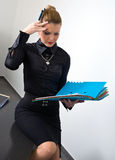 Stressed businesswoman with documents Royalty Free Stock Photos