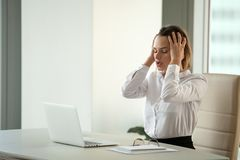 Stressed businesswoman feeling despair suffering from overwork royalty free stock photo
