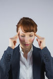 Stressed businesswoman getting a headache Royalty Free Stock Image