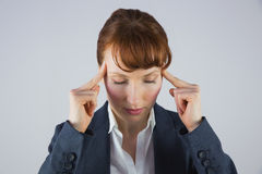Stressed businesswoman getting a headache Stock Images