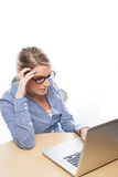 Stressed businesswoman glaring at her laptop Stock Images