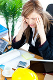 Stressed businesswoman having a headache Stock Photography