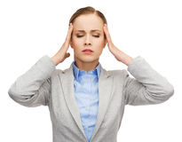Stressed businesswoman having headache Royalty Free Stock Photo
