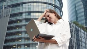 Stressed businesswoman with laptop computer failed deal. Unhappy woman in panic. Female standing near business center stock footage