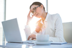 Stressed businesswoman at laptop Royalty Free Stock Photo