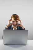 Stressed businesswoman looking at laptop Stock Image