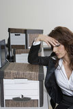 Stressed Businesswoman And Moving Boxes Royalty Free Stock Photography
