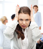 Stressed businesswoman in office royalty free stock images