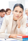 Stressed businesswoman in office Stock Photo