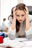 Stressed businesswoman in office Royalty Free Stock Photography