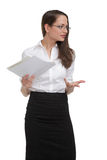 Stressed businesswoman with papers gesturing Royalty Free Stock Images