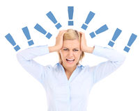 Stressed businesswoman. A picture of a tired and stresses businesswoman shouting over white background Stock Images