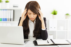 Stressed  businesswoman sitting in office Stock Photo