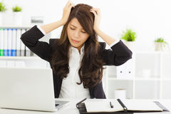 Stressed  businesswoman sitting in office Stock Photography