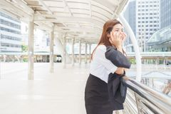 Stressed businesswoman at sky walk after being dismissed - fire stock photos