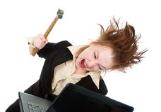 Stressed businesswoman smashing her laptop Royalty Free Stock Photos