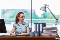 The stressed businesswoman with stack of papers Royalty Free Stock Photo