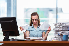 The stressed businesswoman with stack of papers Royalty Free Stock Images