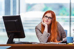 The stressed businesswoman with stack of papers Royalty Free Stock Image