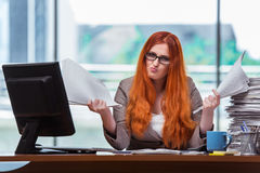The stressed businesswoman with stack of papers Royalty Free Stock Photography