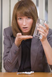 Stressed Businesswoman Taking Pills Royalty Free Stock Image