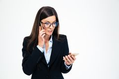Stressed businesswoman talking on the phone Stock Images