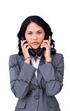 Stressed businesswoman tangled up in phone wires Royalty Free Stock Photos