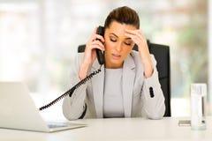 Stressed businesswoman telephone Stock Photos