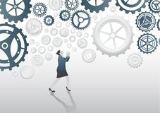 Stressed businesswoman under cogs and wheels Stock Images