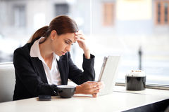 Stressed businesswoman working Royalty Free Stock Photo