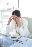 Stressed businesswoman working at her desk Royalty Free Stock Photo