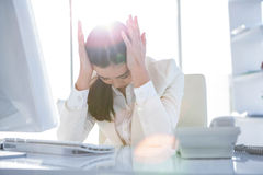 Stressed businesswoman working at her desk Stock Photography