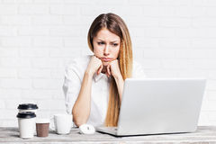 Stressed businesswoman. Young business woman has a headache Royalty Free Stock Photos